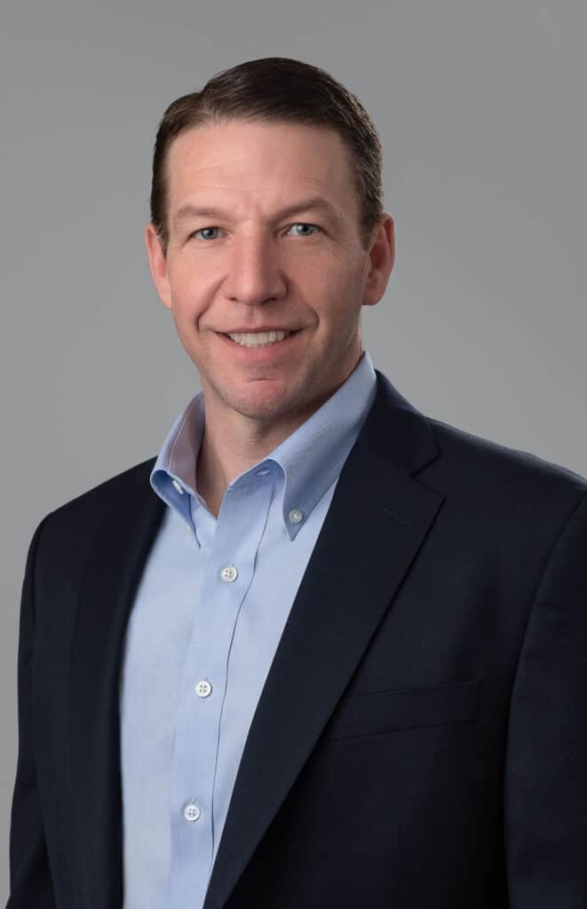Business headshot on gray background